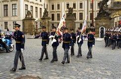 Guard of honor in full dress walking down the street, Prague, Cz. Prague, Czech Republic, May 14, 2009. guard of honor in full dress walking down with flags of Stock Photo