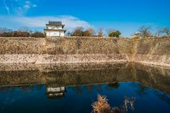 Guard House. The Osaka Castle guard house at the edge of the complex wall, reflected on the moat Stock Photo