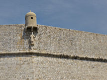 Guard house and patron on Dubrovnik wall Stock Photo