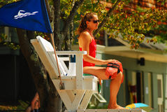 On Guard. A lifeguard keeps a vigilant watch at Walden Pond, Massachusetts Stock Photo