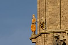 Guard and lion sculpture, detail of the Belfry of Ghent royalty free stock photos