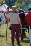 Guard with Pole Weapon and Straw Hat during Medieval Event Fair Stock Photography