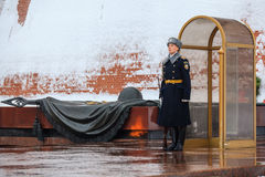Guard of the Presidential regiment of Russia near Tomb of Unknown soldier and Eternal flame in Alexander garden near Kremlin wall. Stock Photos