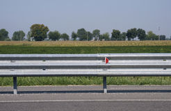 Guard rail along a country road Royalty Free Stock Photo