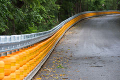 Guard rail along a road Royalty Free Stock Photo