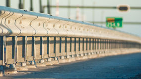 Guard rail is a system designed to keep people or vehicles Stock Photography