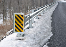 Guard rail and warning sign. Along rural road stock images