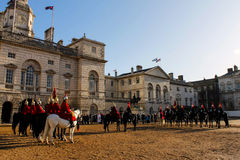 Guard with red dress on horses in buckingham palace with daylight Royalty Free Stock Image