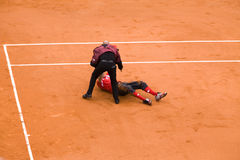 Guard service delayed fan of running in on court. PARIS - JUNE 7:Guard service delayed unidentified fan spectator of running in on court at French Open, Roland royalty free stock image