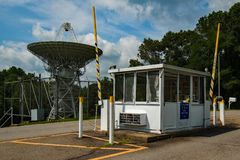 Guard Shack at PARI. Guard Shack with radio telescope royalty free stock photos