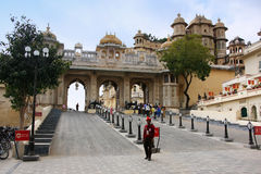Guard standing by the Main gate of City Palace complex, Udaipur, India Stock Image