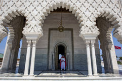 A guard stands at the entrance to the Mausoleum of Mohammed V located in Rabat, Morocco. Royalty Free Stock Photo