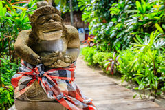 Guard statue in checked sarong, Nusa Lembongan, Indonesia Royalty Free Stock Photography