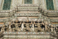 Guard statues around the base at Wat Arun or Temple of Dawn. Tha Stock Image