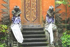 Guard statues in the Ubud Palace at Bali Stock Photos