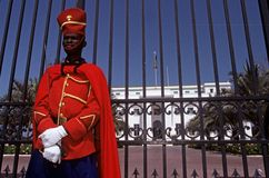 A guard stood outside of the Presidential Palace, Dakar Royalty Free Stock Photos