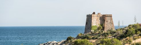 Guard tower on the coast. This is an ancient coastal guard tower at Almunecar in southern Spain. It`s role was to help protect against pirates and other invaders stock photography