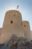 Guard tower of desert fort. Guard tower of a desert fort with flag on a flag pole Royalty Free Stock Photo