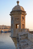 The Guard tower the Gardjola of the Singlea bastion. Malta. The Guard tower on the end of Senglea peninsula bastion with sculpted symbols  eye, ear crane bird Royalty Free Stock Photo