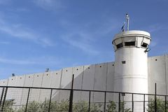 Guard tower next to border wall. Guard tower in front of border wall between Israel and Palestine near Bethlehem royalty free stock photo