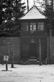 Guard tower next to the gate of the concentration camp. Royalty Free Stock Images