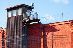 A guard tower on prison wall. A guard tower and prison wall in Helsinki prison royalty free stock photo