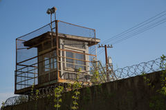 Guard tower prison wire security fence. Watchtower criminal zone barbed fence jail nobody Stock Photography