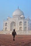 Guard walking at Taj Mahal complex in Agra, Uttar Pradesh, India Royalty Free Stock Images