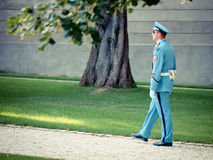 Guard walks thorugh the gardens of Prague Castle Stock Image