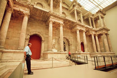 Guard watches the order near the artifact of Market Gate of Miletus Royalty Free Stock Photo