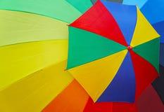 Guarda-chuva grande e pequeno colorido Imagens de Stock