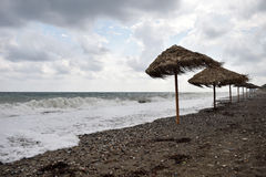 Guarda-chuvas na praia no inverno Fotografia de Stock Royalty Free