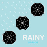 Guarda-chuvas postos acima na chuva Foto de Stock