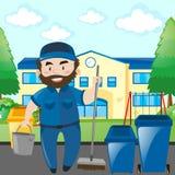 Guarda de serviço que limpa o terreno da escola Imagem de Stock
