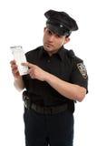 Guarda del tráfico del policía con el boleto de la infracción Foto de archivo libre de regalías