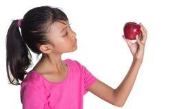 Guardando Apple vermelho III Foto de Stock Royalty Free