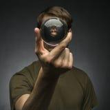 Guardando Crystal Ball Imagem de Stock Royalty Free