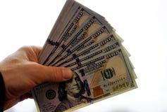 Guardando o dinheiro à disposição imagem de stock