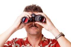 Guardando tramite il binocolo Fotografia Stock