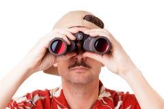 Guardando tramite il binocolo Immagine Stock