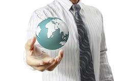 Guardando um globo de incandescência da terra em suas mãos Fotografia de Stock