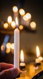 Guardando uma vela Imagem de Stock Royalty Free