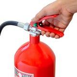 Guardarando o extintor Fotografia de Stock Royalty Free