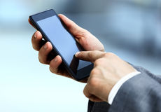 Guardarando o telefone Foto de Stock