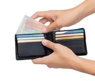 Guardarar e tomou o dinheiro fora do bolso isolado sobre o branco Foto de Stock Royalty Free