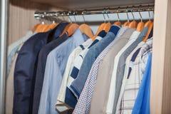 Guardaroba dei vestiti degli uomini Immagine Stock Libera da Diritti
