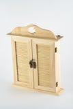 Guardarropa de madera de la muñeca Imagenes de archivo