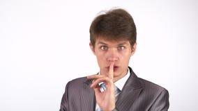 Guarde el silencio, gesto del hombre joven almacen de video