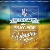 Guarde la calma y ruegue para el cartel de Ucrania Imágenes de archivo libres de regalías
