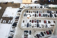 Guarded parking lot with many cars in winter Stock Photo
